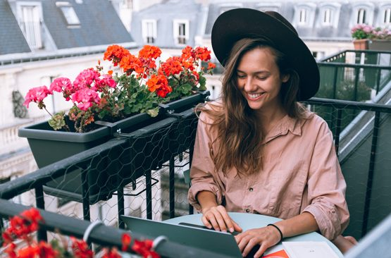 Eco-friendly travel: girl working from home