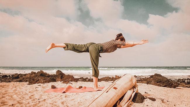 Bagmaya best yoga backpack beach photo with woman doing yoga pose