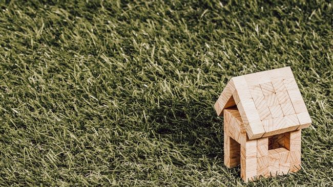 Eco-friendly little wooden house on the grass