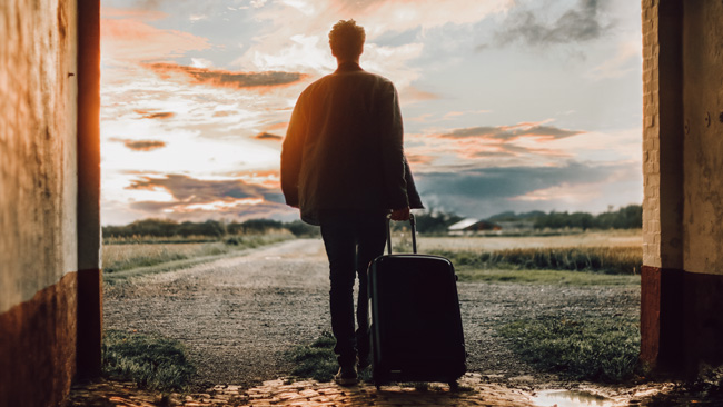 sustainable travel guy with suitcase