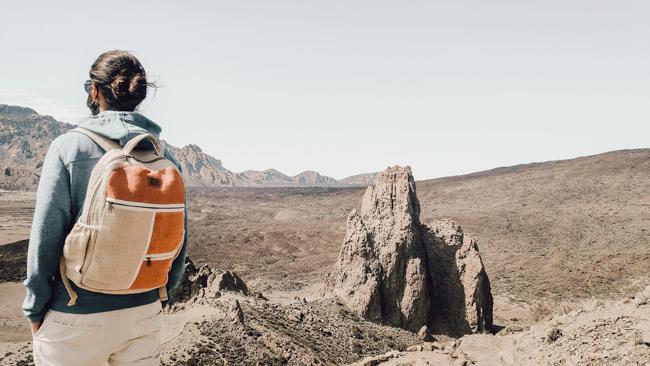 sustainable traveller wearing red hemp backpack
