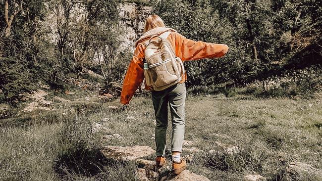 girl slow travelling in countryside with hemp Bagmaya backpack