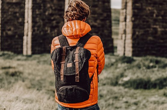 Guy building a sustainable wardrobe wearing bagmaya sustainable backpack in nature