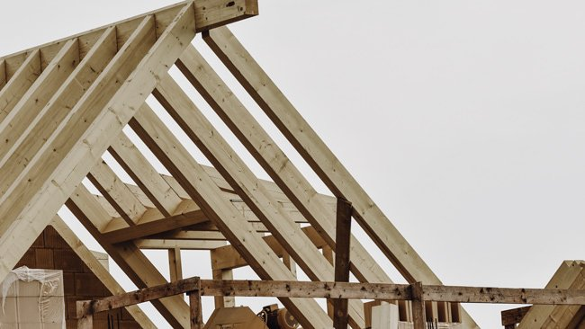 Eco-friendly building materials being used to make a house, timber roofing outline