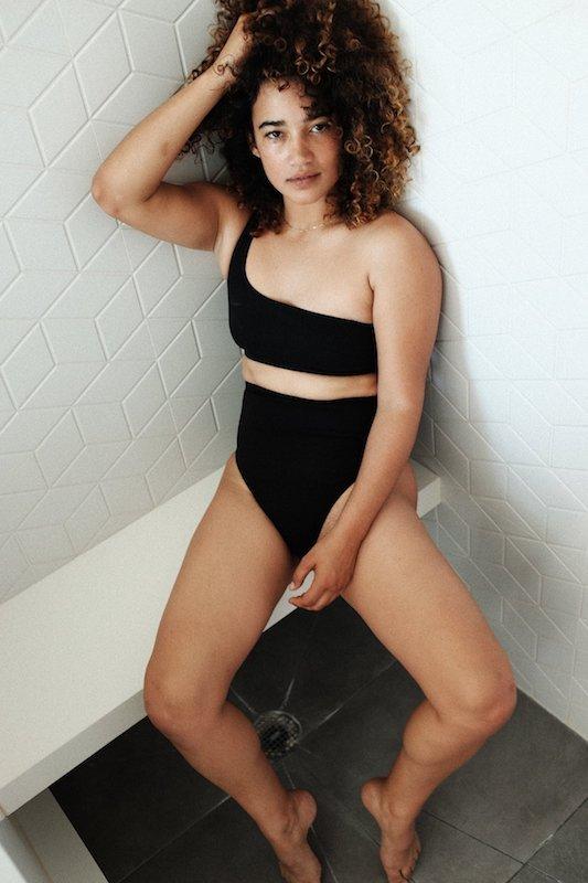 A woman wearing black hemp bikini by Natasha Tonic
