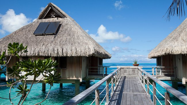 Tahiti eco-hotels with solar panels on roofs