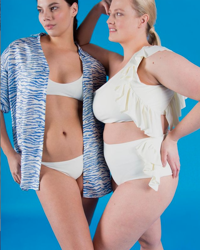 Two plus size models wearing Paper London's sustainable bikinis