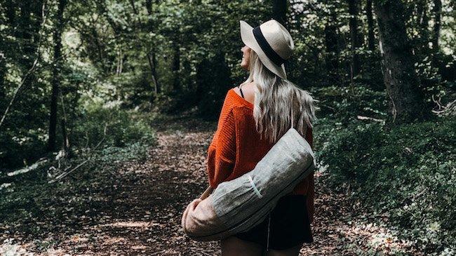Girl carrying an eco friendly hemp yoga mat bag